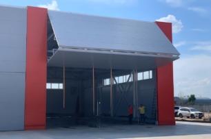 Производство зданий из металлоконструкций с эксклюзивными воротами